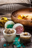 Bronze bowl with water and accessories spa treatments Royalty Free Stock Photos