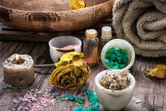 Bronze bowl with water and accessories spa treatments. Sea salt and accessories for a rejuvenating spa sessions Stock Photo