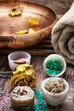 Bronze bowl with water and accessories spa treatments. Sea salt and accessories for a rejuvenating spa sessions Royalty Free Stock Photography