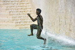 Bronze boy statue in fountain Stock Photography
