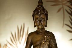 Bronze Buddha. Buddha in lotus position with illumine background Royalty Free Stock Image