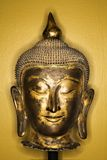 Bronze Buddha head. Royalty Free Stock Photo