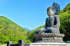 Bronze Buddha of Sinheungsa Temple. Tongil Daebul, or the Great Unification Buddha, at  Sinheungsa Temple in Seoraksan National Park in South Korea Stock Image