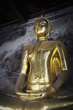 Bronze buddha statue at Bangkok temple in Thailand in Asian culture and religion concept Stock Image