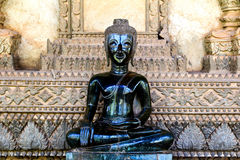 Bronze Buddha statue at the Haw Phra Kaew Stock Photography