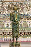 Bronze Buddha statue. Standing statue of lord Buddha made of bronze at Wat Arun - Temple of dawn in Bangkok, Thailand Stock Image