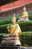 Bronze buddhas at antique pagoda in Chiangmai Stock Photos