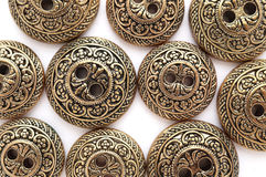 Bronze buttons with baroque pattern Stock Photography