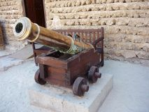 Bronze Cannon with cannonballs Stock Images