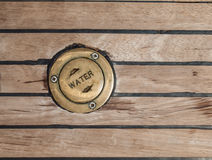 Bronze cap in teak deck Stock Photography