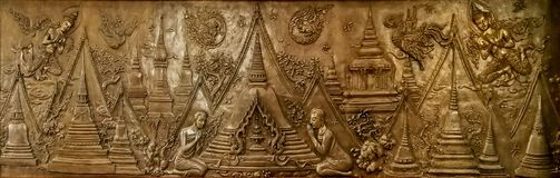 Bronze cast art of many temples beside Buddha`s bone urn, his di stock photography