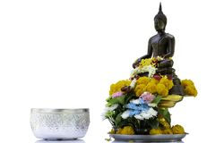 Bronze cast Buddha image decorate with beautiful flowers and garland for pray on Songkarn festival on white background. Bronze cast Buddha image decorate with Royalty Free Stock Photos