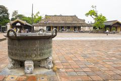 Bronze cauldron on courtyard of Hue citadel. Big cauldron on courtyard of Can Chang palace in Hue Citadel royalty free stock photography