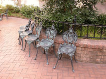 Bronze chairs. In a courtyard in Savannah Georgia royalty free stock photography