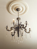 Bronze chandelier with crystals. Shot against a ceiling Stock Photography