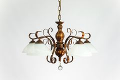 Bronze Chandelier White Plafonds. Chandelier vintage bronze with white plafonds on the gray background Stock Image