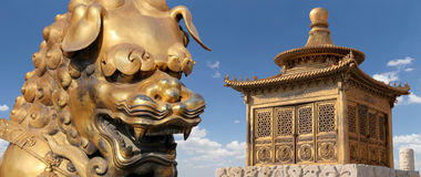 Bronze Chinese dragon statue and bronze pagoda. Beijing, China Royalty Free Stock Photos