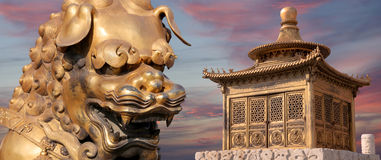 Bronze Chinese dragon statue and bronze pagoda. Beijing, China Royalty Free Stock Photography