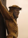 Bronze Christ on the Cross. Photograph taken from a Church garden in Mexico Stock Photo