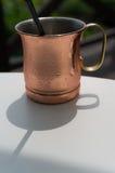Bronze coffee mug Stock Photo