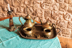 Bronze coffee service on the table Royalty Free Stock Photo