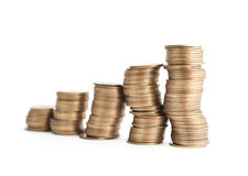 Bronze coins stand vertically in crooked columns Stock Photos