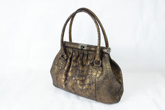 Bronze coloured crocodile skin handbag royalty free stock images