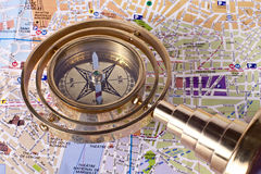 Bronze compass on a map. Bronze compass with handle on a map Stock Photos