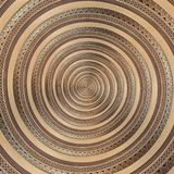 Bronze copper geometrical abstract ornament spiral fractal pattern background. Metal spiral pattern effect background swirl shape. Bronze copper geometrical Royalty Free Stock Photography