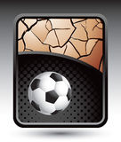 Bronze cracked background with soccer ball Royalty Free Stock Image