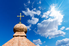 Bronze Cross on Blue Sky Royalty Free Stock Images