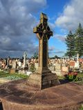 Bronze Cross in Cemetery Royalty Free Stock Images