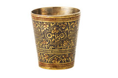Bronze cup with ornament on a white background. Bronze yellow cup with ornament on a white background stock photos