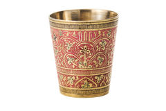 Bronze cup with ornament on a white background. Bronze yellow cup with ornament on a white background royalty free stock photo