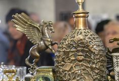 Bronze decanter with a volumetric pattern in a gift shop stock image