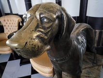 Bronze dog in the restaurant Stock Image
