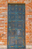 Bronze door in the brick wall Stock Photography