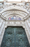 Bronze door and mosaics of cathedral in Florence Royalty Free Stock Image