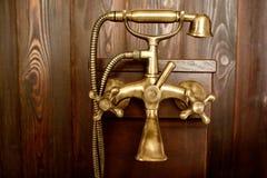 Bronze douche in a bathroom Stock Photo