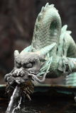 Bronze dragon. Traditional bronze dragon fountain to wash your hands before entering a japanese temple Royalty Free Stock Image
