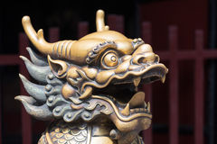 Bronze dragon head sculture at the entrance of a buddhist temple Stock Photography