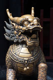 Bronze dragon head sculture at the entrance of a buddhist temple Royalty Free Stock Images
