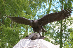 Bronze eagle taking off a stone monument Stock Photography