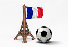 Bronze Eiffel Tower model with french flag and soccer ball Royalty Free Stock Image
