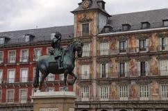 Bronze equestrian statue of King Philip III and Casa de la Panad Stock Image