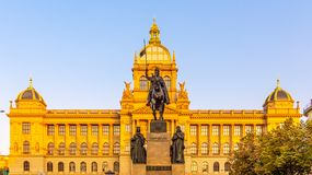The bronze equestrian statue of St Wenceslas at the Wenceslas Square with historical Neorenaissance building of National. Museum in Prague, Czech Republic royalty free stock image