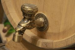 Bronze faucet on a barrel of wine