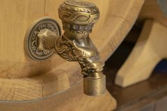 Bronze faucet on a barrel of wine stock photo
