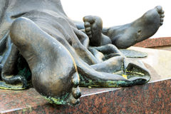 Bronze feet of a statue Royalty Free Stock Image