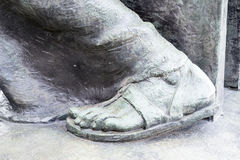 Bronze feet of a statue Stock Image